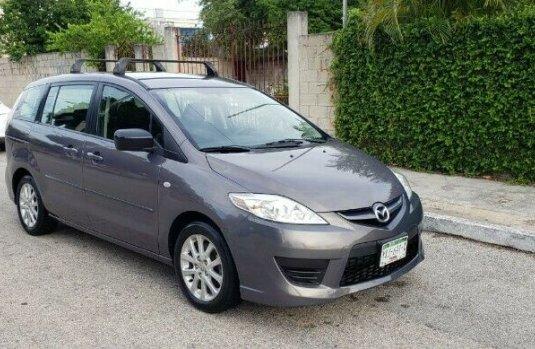 Mazda 5 sport 2009 aut con clima bolsas de aire electrica 3 filas de asientos motor 4 cil fac orig