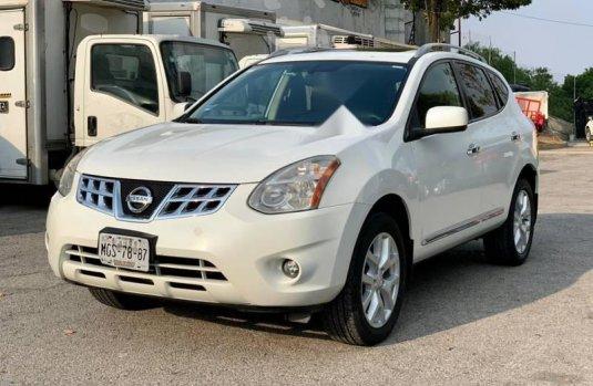 Nissan Rogue factura original todo pagado 2011